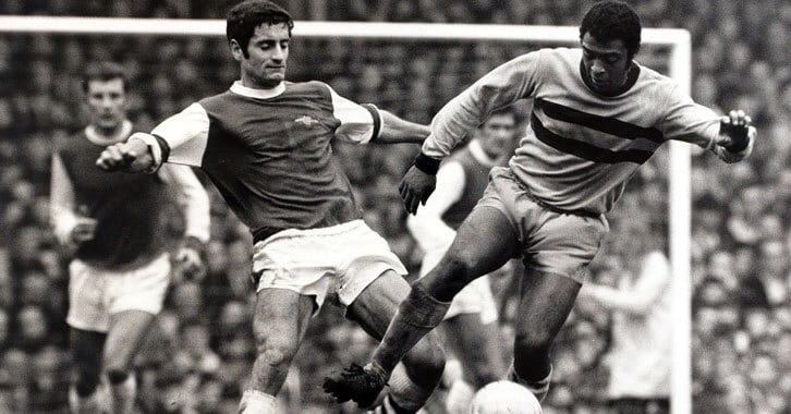 John Charles tackling another professional soccer player from Arsenal