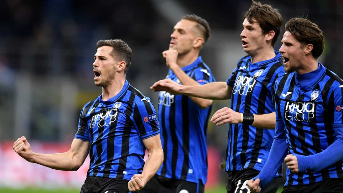 Atalanta playing in champions league and celebrating a goal