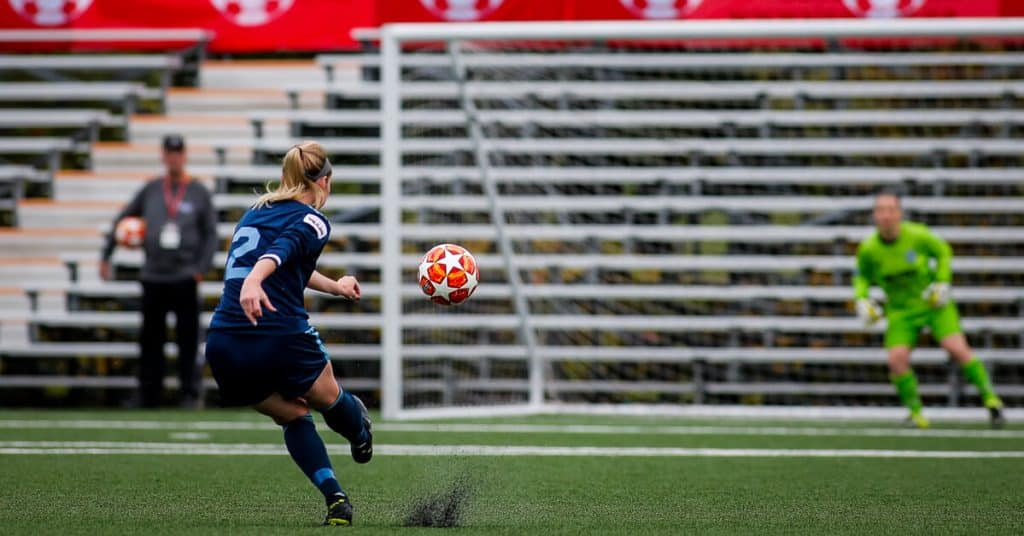 girl shooting for goal in pursuit to score a hat trick