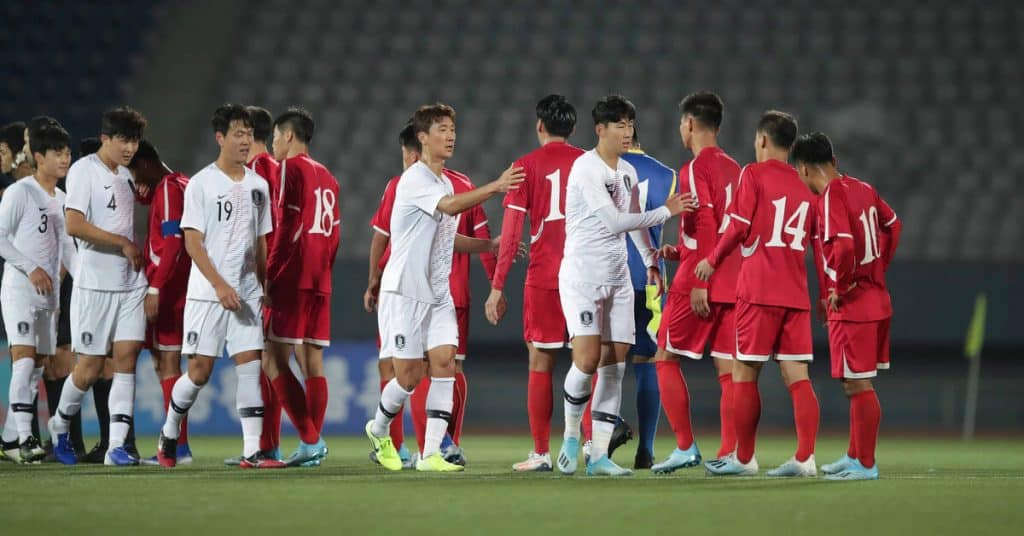 north korea world cup 2010 squad shaking hands with south korea players before a qualifying game