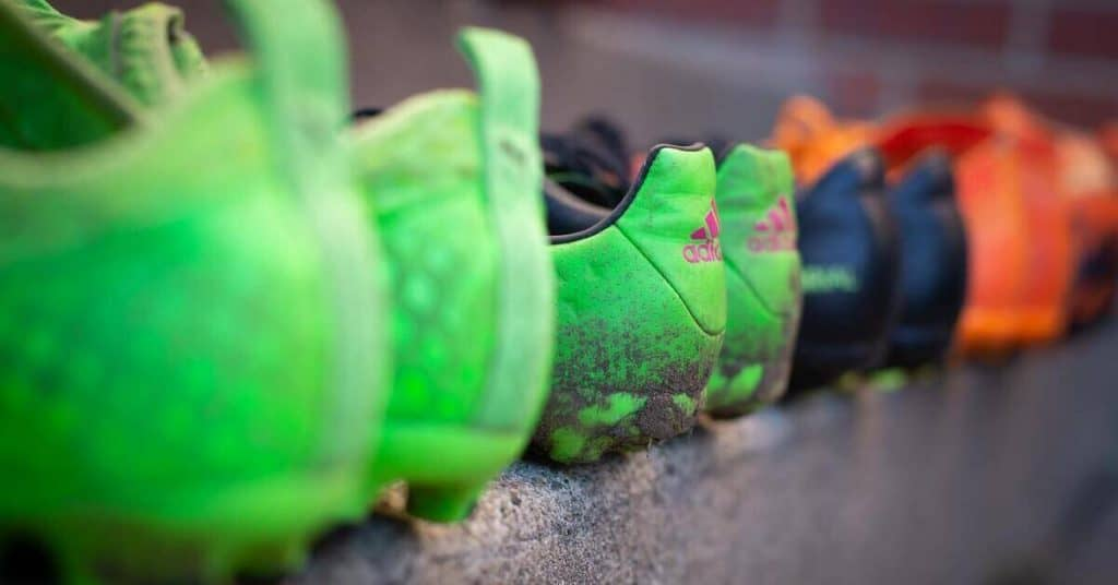 row of soccer cleats sitting on a step